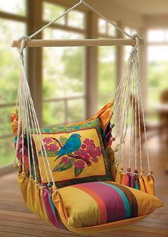 The blue color is really pretty with the yellow, pink, orange and brown tones of the hammock…so inviting!