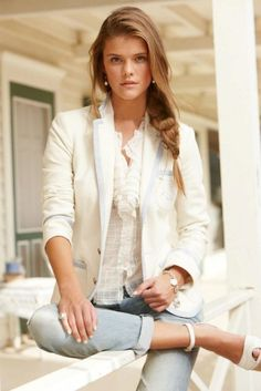 A white blazer and light blue distressed slim jeans will showcase your sartorial self. A pair of white leather wedge sandals will seamlessly integrate within a variety of outfits.   Shop this look on Lookastic: https://lookastic.com/women/looks/blazer-button-down-blouse-skinny-jeans/18545   — White Button Down Blouse  — White Blazer  — Silver Bracelet  — Light Blue Ripped Skinny Jeans  — White Leather Wedge Sandals