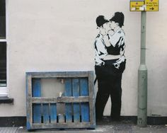 Kissing Coppers - Two policemen kissing is an open advocacy for gay rights, another activist action of Banksy.