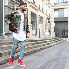Marry a dark green camouflage bomber jacket with baby blue ripped slim jeans for…