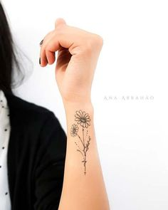 13 Flower Tattoo Ideas for Every Women Floral, Upper Wrist Tattoo Idea Pink Flower Tattoos, Sunflower Tattoos, Flower Tattoo Arm, Daisies Tattoo, Floral Tattoos, Wrist Tattoos For Women, Tattoos For Guys, Arm Tattoos For Women Upper, Tattoo Women