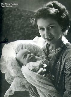 The Queen, then Duchess of Edinburgh nursing Princess Anne in 1950, she is wearing a small diamond brooch, given to her by Prince Philip. It is a copy of his Naval badge, he was still a serving Naval Officer when they were 1st married.