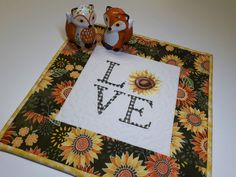 """Embroidered Sunflower Candle Mat, Valentine LOVE Quilted Table Topper, Green Yellow Orange Floral Mug Mat, 12.5""""x12.5"""" by VillageQuilts on Etsy"""