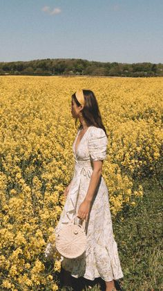 Countryside in And Other Stories ruffled linen wrap midi dress and round woven bag. | @sarahchristine