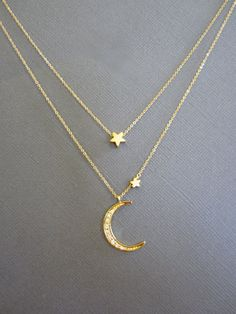 Simple everyday 18K gold plated over Sterling Silver star and CZ Embdedded crescent Moon charm Necklace on Gold fill chain.   *Star measures approx. 4mm *Moon Measures approx. 15mm x 20mm *Big Star measures 6mm ---------------------------------------------------------------------- Legnth of the necklace in the picture is 18 + 20 ---------------------------------------------------------------------- *Jewelry card options- please indicate your choice of a message or your personals message in…