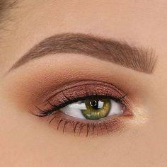 Contoured eye shadow with winged eyeliner