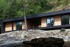 Hungarian architects Attila Béres and Jusztina Balázs recently completed the Hideg House, a holiday home clad in larch wood framing views in a former stone quarry. Architecture Résidentielle, Contemporary Architecture, Cabin Design, House Design, Green Design, Architects Journal, Timber Cabin, Stone Quarry, Wooden Cabins