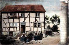 Ansichtskarte / Postkarte Hessen, Familie vor ihrem Wohnhaus in hessischen Trachten  #Schwalm