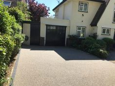 Resin Bound Driveways are mixed of natural aggregate, marble or recycled glass (stone) and clear resin. Book your free survey today or call 0800 1700 636 Resin Bound Driveways, Resin Driveway, Driveway Landscaping, House Front, Recycled Glass, Home Renovation, Hampshire, Exterior, Outdoor Decor