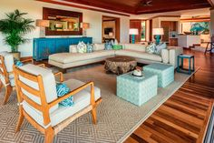 Accent pieces in shades of blue bring coastal flair to this Hawaiian living room. - Photo: courtesy of Hualālai Resort