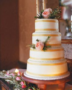 To help the pair pick their cake from out-of-state, Cakes by Jane mailed Erin and Jason fresh samples to taste. The couple decided on alternating tiers of almond and cappuccino cake frosted with buttercream and trimmed with a gold ribbon.