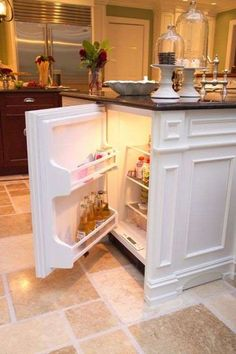 The door on this mini fridge totally blends into the cabinetry. great for additional drinks during parties or for kids snacks/drinks