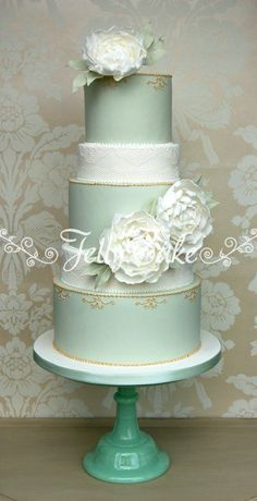 LOVE the colors and intricate details of this wedding cake