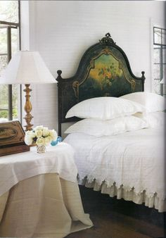 Coverlet on bed, mix of white & beige, cream