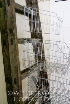 Thursday, January 2011 Vertical Storage with Vintage Wire Baskets & an Antique Ladder - Really unique and fun craft organization inspiration. Antique Ladder, Old Ladder, Vintage Ladder, Leaning Ladder, Vintage Decor, Craft Fair Displays, Store Displays, Display Ideas, Booth Displays