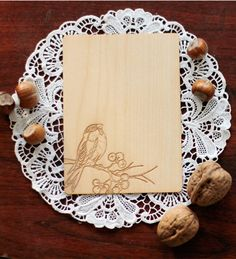 Real wood wedding invitations engraved with a bird on a branch [Yes. LOVE this idea.]