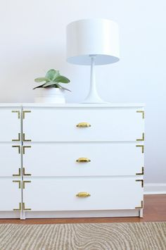 IKEA drawers with brass corner braces and pulls