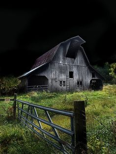 I love this old barn and I love the night and the gate... it's a gorgeous country icon