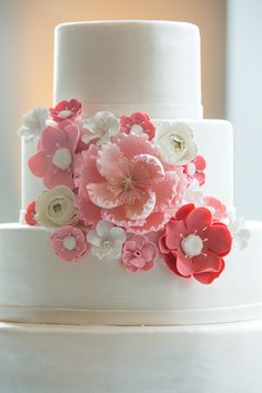 Smooth & Sleek 4-Tiered Wedding Cake with pink to coral flowers by  FancyCakesByLeslie.com -   See the wedding  here: http://www.StyleMePretty.com/2014/05/12/courageous-bride-proves-bald-is-beautiful/ Photography: Andrea Jacobson For The Observatory - observatoryphoto.com on #SMP