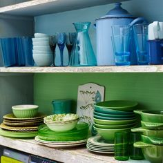 Like how the dishes are organized by colours and the shelves background is the same colour theme  - Sköna hem