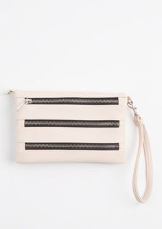 Perfectly compact yet able to hold so much! This fold-over crossbody purse is built with textured faux leather and features 3 decorative zips at the front.