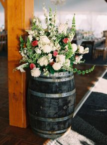 barrels with flower arrangements