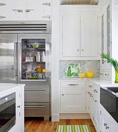 Beautiful Refrigerator and I love the pop of green.