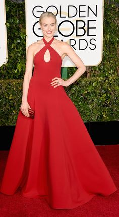 Taylor Schilling makes her 2015 Golden Globes red-carpet statement - in scarlet Ralph Lauren. She wears a custom Collection halter gown.