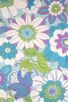 Blue Floral Wallpaper. Original retro floral wallpaper with a colorful flower pattern in blue, green and purple color.