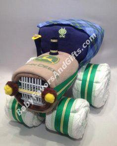 Tractor Diaper Cake - diapers - fleece blanket - receiving blanket - pair of baby socks - bodysuit - dishwasher basket Baby Shower Diapers, Baby Boy Shower, Diaper Cake Boy, Cake Baby, Unique Diaper Cakes, Diaper Cake Centerpieces, Baby Favors, Best Baby Gifts, Unique Baby Shower Gifts