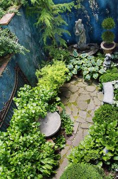 This moody blue wall, which sets off the plantings beautifully, is just part of the appeal of this small shaded space. Other pluses: the sto...