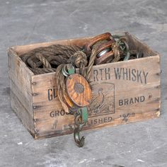 Old whiskey box with ropes and pulleys