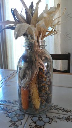 I put some popcorn, indian corn in a 1/2 gallon mason jar fir a table decoration :-)