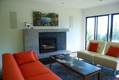 Contemporary fireplace design mixing large scale and small scale mosaic tile.