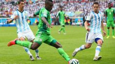 PORTO ALEGRE, BRAZIL - JUNE 25: Emmanuel Emenike of Nigeria controls the ball against Angel di Maria (L) and Fernando Gago of Argentina during the 2014 FIFA World Cup Brazil Group F match between Nigeria and Argentina at Estadio Beira-Rio on June 25, 2014 in Porto Alegre, Brazil. (Photo by Ian Walton/Getty Images)  2014 FIFA World Cup Brazil™: Nigeria-Argentina - Photos - FIFA.com Laws Of The Game, International Football, Fifa World Cup, Brazil, Highlights, June, Group, Porto, Argentina