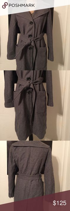 """Banana Republic Wool Blend Trench Coat This is a size medium made of 87% wool and 13% nylon. It is in excellent condition but please keep in mind that this is a used item. It is dry clean only and though not recently dry cleaned  it has not been recently worn nor does it have any smells due to storage that I can discern. It measures 20"""" armpit to armpit it measures 37"""" long from shoulder to hem the sleeves are 24.5"""" long and the waist measures 17.5"""". Banana Republic Jackets & Coats Trench…"""