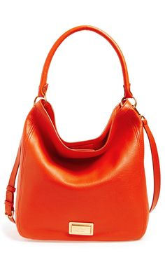 The bright orange color of this clean, contemporary Marc Jacobs hobo bag will add a nice pop of color to the fall wardrobe.