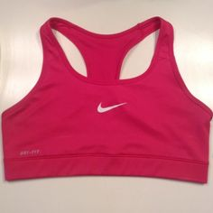 NWT Hot Pink Dri-fit Nike Sports Bra Nwt  Dri-fit Hot Pink Nike unlined sports bra *Very tiny almost unnoticeable amount of cracking on the swoosh* Size Large Super cute Nike Tops