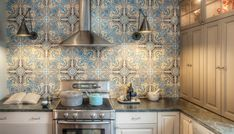 Love the tile backsplash and the swing-arm light fixtures!