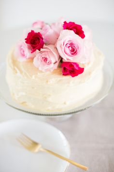 Spiced poppyseed cake with almond buttercream frosting & fresh flowers.