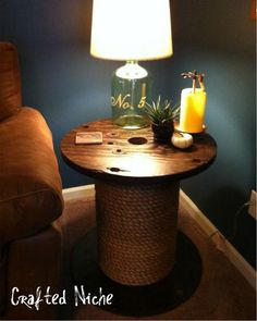 Side Table from an old spool. Take care of 2 birds with one stone and have an extra scratching post for your cat in a corner disguised as a table