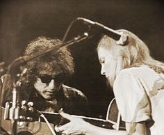 Joni Mitchell jamming with Bob Dylan.