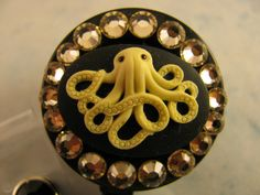 Octopus Cameo Retractable ID Badge Reel Holder with Swarovski Elements by sparklinghope on Etsy https://www.etsy.com/listing/254126629/octopus-cameo-retractable-id-badge-reel