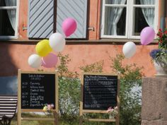 Chalkboard wedding signs with balloons