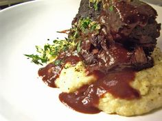 Cabernet-braised short ribs with gorgonzola polenta and three-herb gremolata