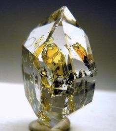 Petroleum trapped inside Quartz crystal