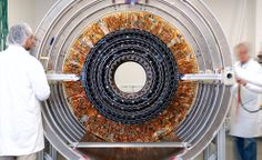 Work on the first half tracker inner barrel/inner disk in the Compact Muon Solenoid clean room, CERN