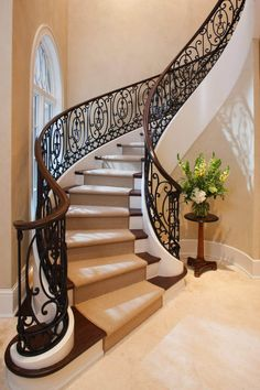 The Architecture Designs presents 22 beautiful traditional staircase design ideas to turn your traditional staircases into a unique one. Explore all ideas here. Wrought Iron Staircase, Winding Staircase, Iron Stair Railing, Staircase Railings, Curved Staircase, Banisters, Grand Staircase, Stairways, Craftsman Staircase
