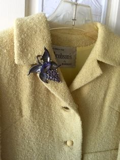 Vintage brooch on a vintage coat http://winterspast.com/vintage-jewelry/how-to-wear-a-vintage-brooch/ #wearvintage