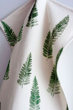 17 Ways To Introduce Botanical Design Into Your Home Decor | A botanical tea towel or two is the perfect way to add some greenery to your kitchen. Here's a DIY for a fern tea towel.